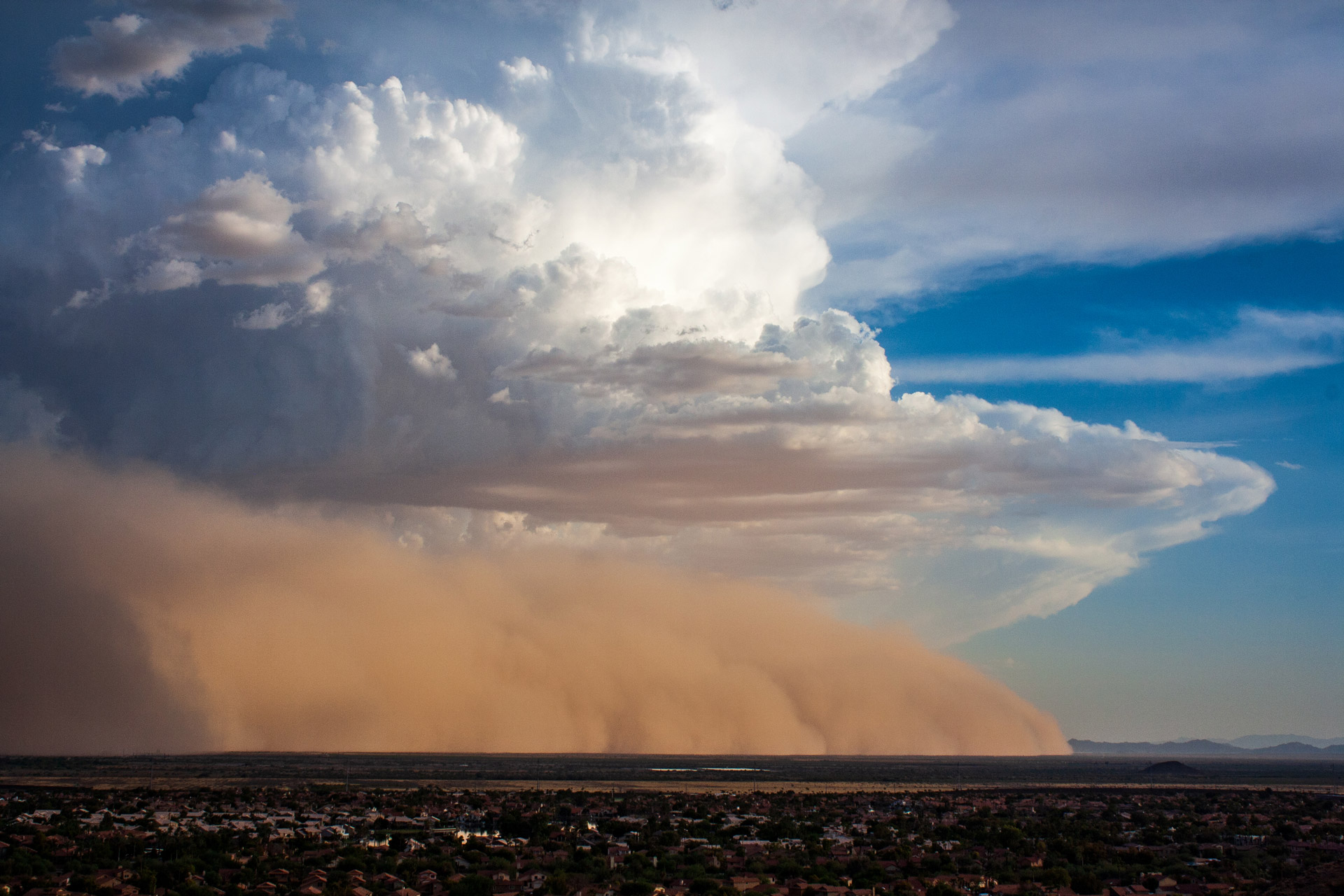 A large dust storm travels northwest towards the Phoenix metro area